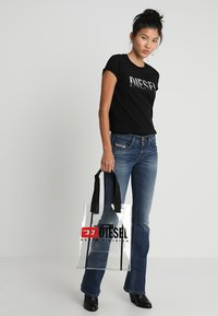 Diesel - D-EBBEY - Bootcut jeans - indigo - 1