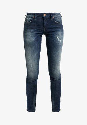 SKINZEE LOW ZIP - Skinny džíny - indigo style exclusive
