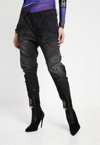 Diesel - FAYZA-NE SP - JOGG - Jeans relaxed fit - dark grey - 0
