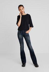 Diesel - D-EBBEY - Jeans bootcut - indigo - 1
