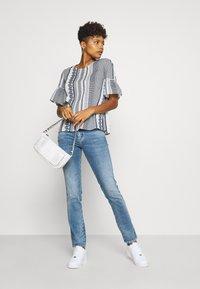 Diesel - D-SANDY - Slim fit jeans - blue denim - 1