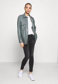 Diesel - SLANDY - Jeans Skinny Fit - washed black - 1