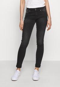 Diesel - SLANDY - Jeans Skinny Fit - washed black - 0