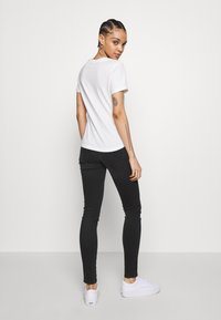 Diesel - SLANDY - Jeans Skinny Fit - washed black - 2