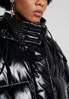 Diesel - ALLA JACKET - Kabát zprachového peří - black