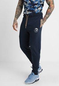 Diesel - UMLB-PETER TROUSERS - Teplákové kalhoty - blau - 0