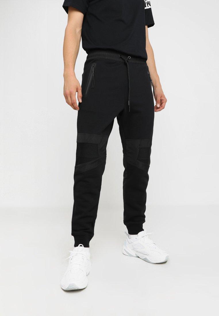Diesel - P-OSAMU-SW TROUSERS - Pantalones deportivos - schwarz