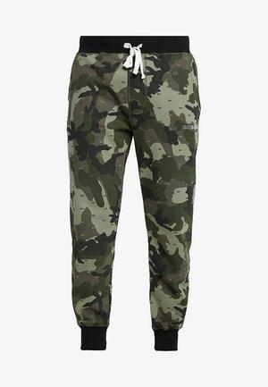 PETER - Pantalones deportivos - olive