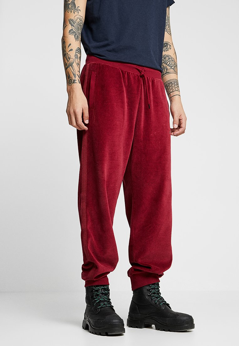 Diesel - DARREN TROUSERS - Tracksuit bottoms - burgundy red
