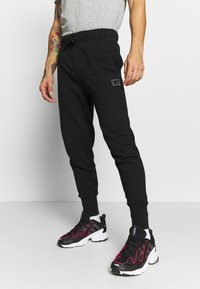 Diesel - UMLB-PETER  - Pantalon de survêtement - black - 3