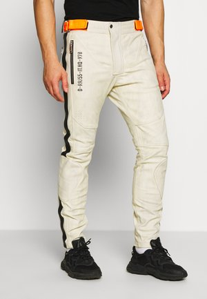 TROUSERS - Leather trousers - cream