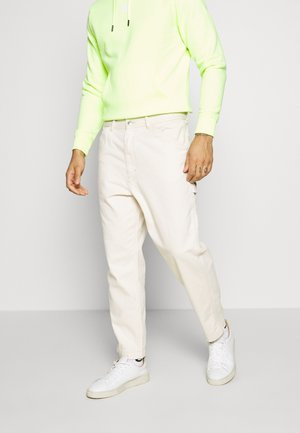 LAMAR TROUSERS - Jeans Tapered Fit - cream