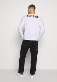 Diesel - LAMAR TROUSERS - Jeans Tapered Fit - black - 2
