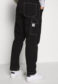Diesel - LAMAR TROUSERS - Jeans Tapered Fit - black