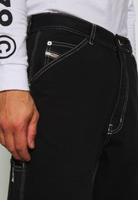 Diesel - LAMAR TROUSERS - Jeans Tapered Fit - black - 6