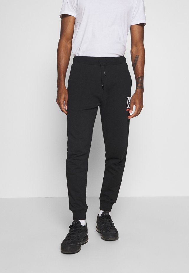 BMOWT PETER BG TROUSERS - Verryttelyhousut - black