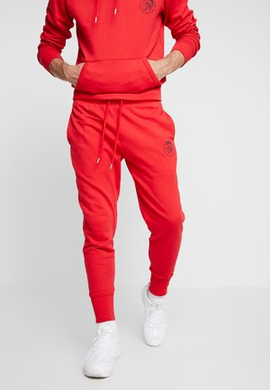 UMLB-PETER TROUSERS - Spodnie treningowe - red