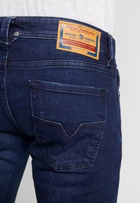 Diesel - LARKEE - Straight leg jeans - dark blue denim - 5