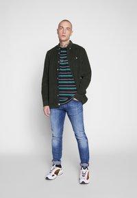 Diesel - TEPPHAR-X - Slim fit jeans - dark blue denim - 1