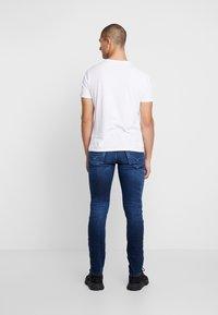 Diesel - THOMMER-X - Slim fit jeans - 0095T01 - 2