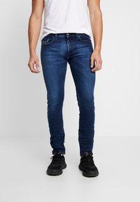 Diesel - THOMMER-X - Slim fit jeans - 0095T01 - 0