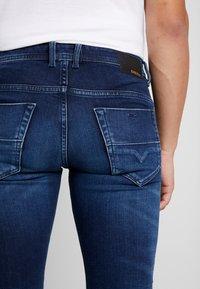 Diesel - THOMMER-X - Slim fit jeans - 0095T01 - 3