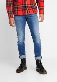 Diesel - THOMMER-X - Slim fit jeans - 0097x01 - 0