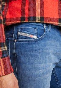 Diesel - THOMMER-X - Slim fit jeans - 0097x01 - 4