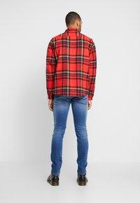 Diesel - THOMMER-X - Slim fit jeans - 0097x01 - 2