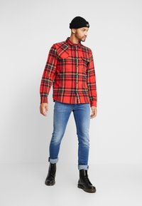 Diesel - THOMMER-X - Slim fit jeans - 0097x01 - 1