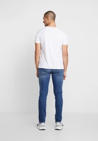 Diesel - THOMMER-X - Slim fit jeans - 0096E01 - 2