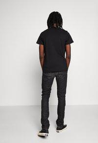 Diesel - THOMMER-X - Slim fit jeans - black denim - 2