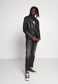 Diesel - THOMMER-X - Slim fit jeans - black denim - 1