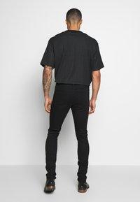 Diesel - D-ISTORT - Jeans Skinny - black denim - 2