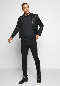 Diesel - D-ISTORT - Jeans Skinny - black denim - 1