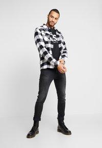 Diesel - D-AMNY-X - Jeans slim fit - black denim - 1