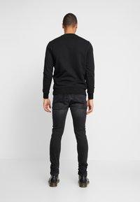 Diesel - D-AMNY-X - Jeans slim fit - black denim - 2