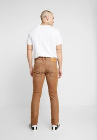Diesel - THOMMER-SP - Jeansy Slim Fit - ochre - 2