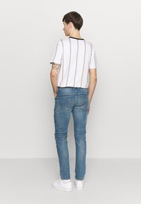 Diesel - THOMMER-X - Slim fit jeans - light-blue denim - 2