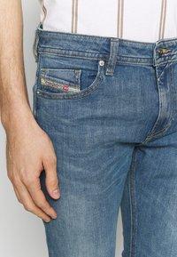 Diesel - THOMMER-X - Slim fit jeans - light-blue denim - 5