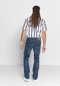 Diesel - SAFADO-X - Jeans a sigaretta - cn03601 - 2