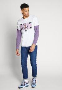 Diesel - THOMMER-X - Slim fit jeans - 0095z01 - 1