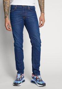 Diesel - THOMMER-X - Slim fit jeans - 0095z01 - 0