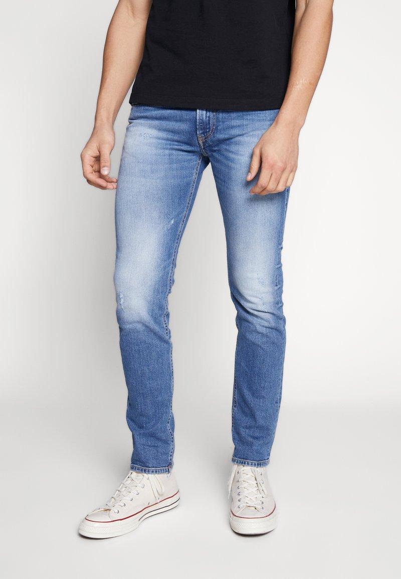 Diesel - THOMMER-X - Slim fit jeans - blue denim