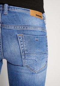 Diesel - THOMMER-X - Slim fit jeans - blue denim - 4