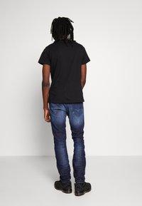 Diesel - THOMMER - Slim fit jeans - dark blue denim - 2