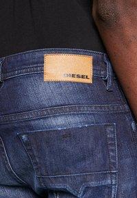 Diesel - THOMMER - Slim fit jeans - dark blue denim - 4