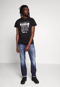 Diesel - THOMMER - Slim fit jeans - dark blue denim - 1