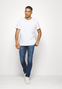Diesel - THOMMER-X - Slim fit jeans - 009de - 1