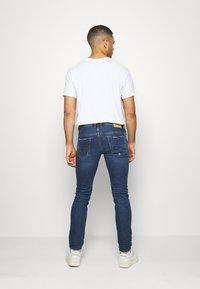 Diesel - THOMMER-X - Slim fit jeans - 009de - 2